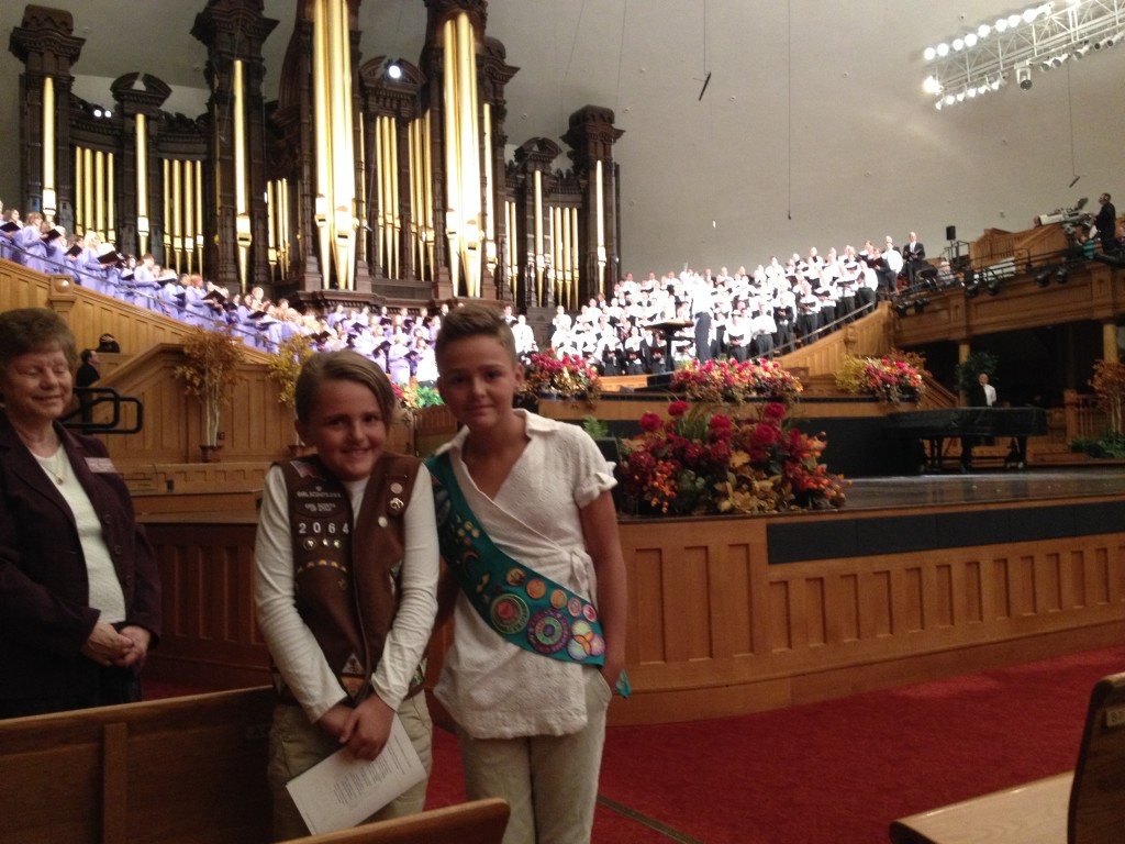 two girl scouts standing in front of the Mormon Tabernacle Choir