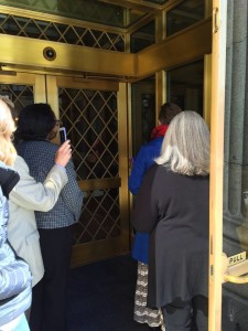 Image: Several women at the door of the Church Administration Building, attempting to deliver Ready to Witness letters