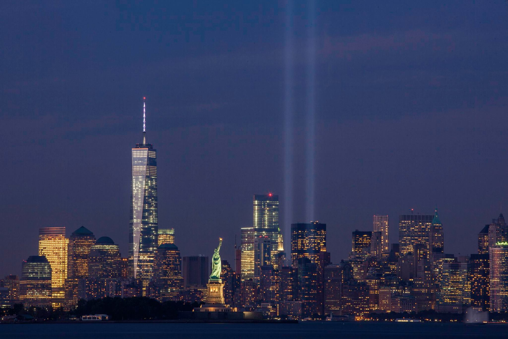Image from the Tribute in Light on September 11, 2014. It shows the New York City skyline with two beams of light representing the fallen towers.