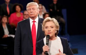 Donald Drumpf looming behind Hillary Clinton at the second presidential debate of 2016.