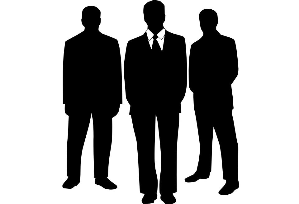 Three silhouette figures of men in suits.