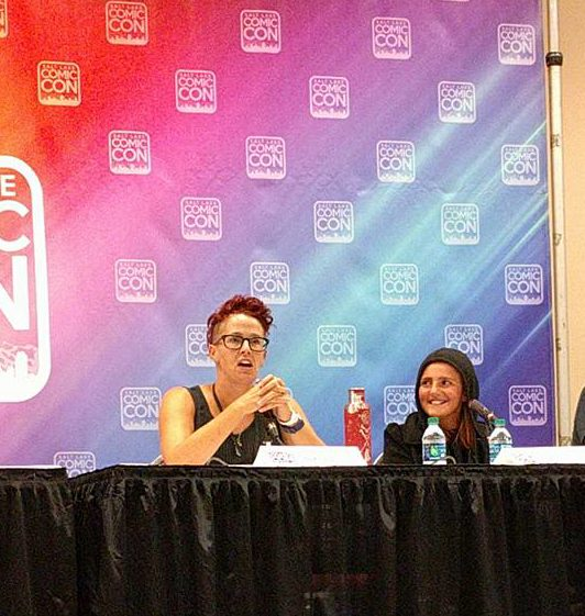 Debra Jenson and her daughter sitting on a panel at the Salt Lake Comic Con